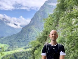 Brother Alain M. Lafon hiking up Wiggis mountain