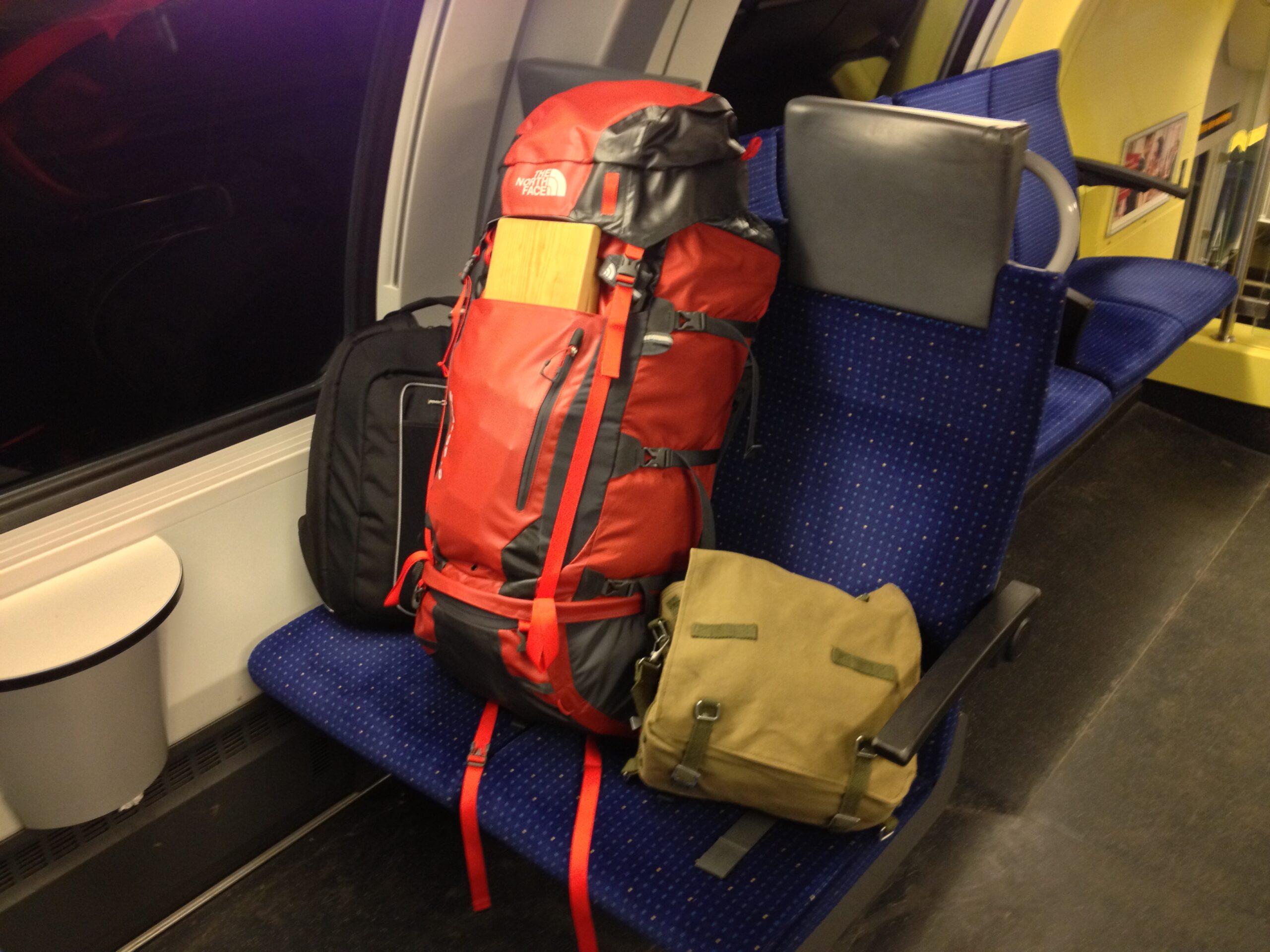 Digital Nomad setup: Computer backpack, clothes, meditation bench, Zen Monk carry bag